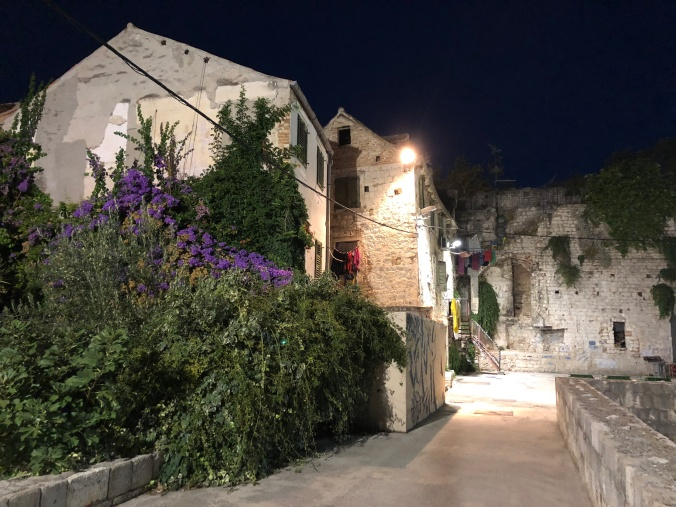 Split At Night: Houses and Palace Walls Draped With Washing