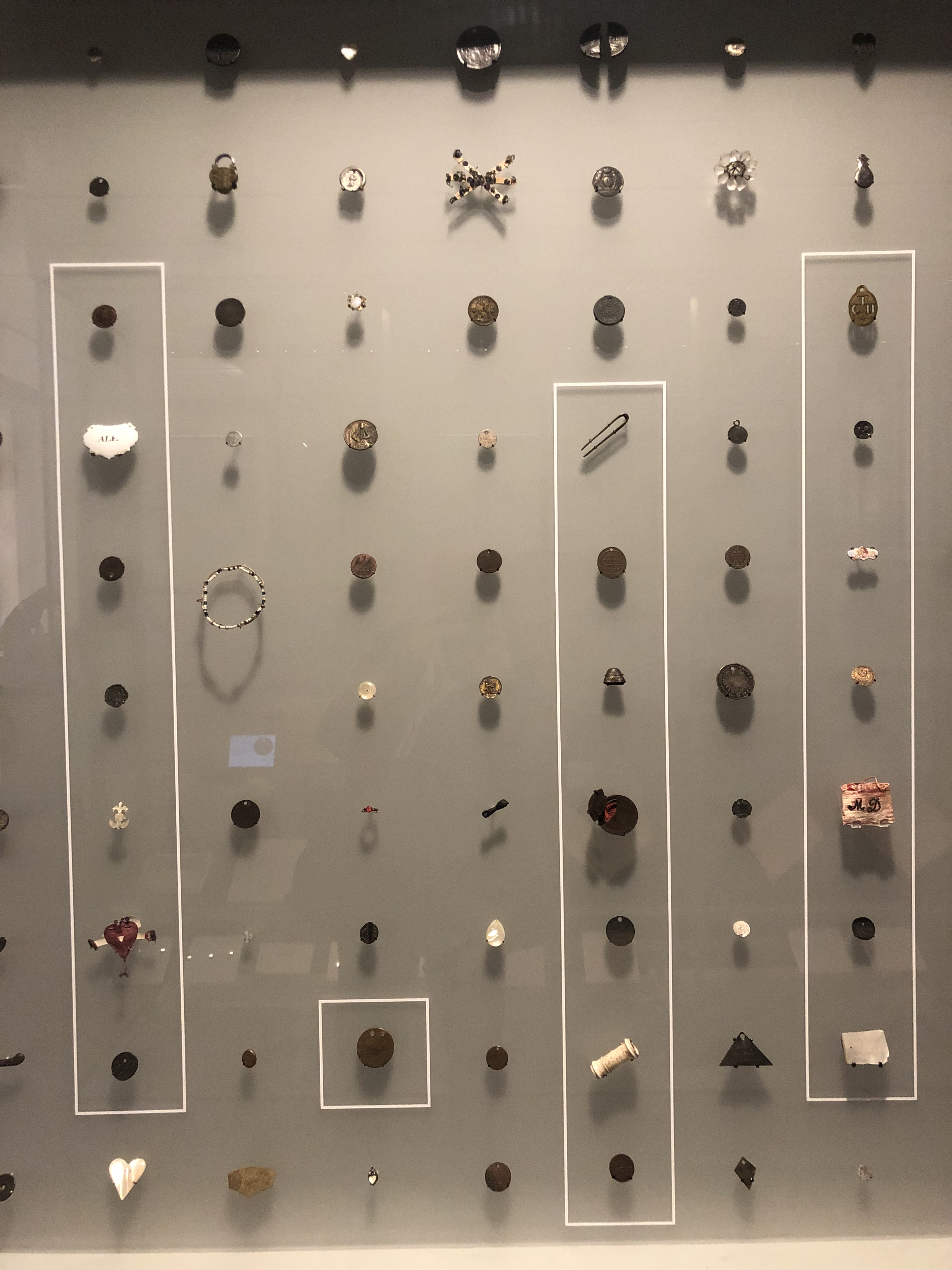 A Selection Of Tokens On Show At The Foundling Museum